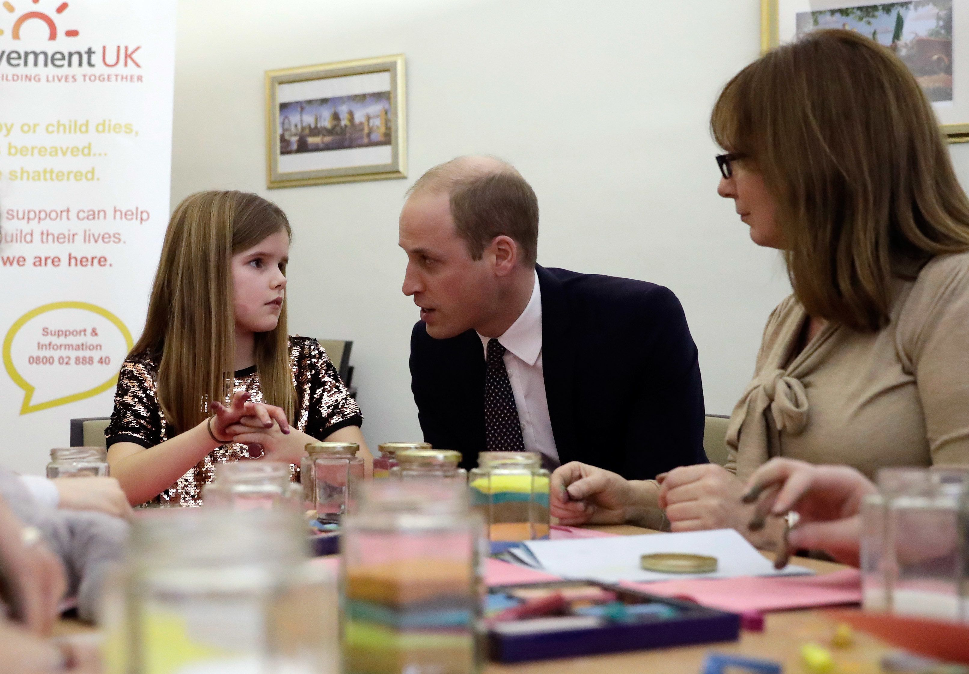 LONDON, ENGLAND - JANUARY 11: Prince William, Duke of Cambridge speaks to Aoife, 9, during his visit to a Child Bereavement UK Centre in Stratford on January 11, 2017 in London, England.  (Photo by Matt Dunham - WPA Pool/ Getty Images)