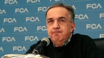 Fiat Chrysler Automobiles CEO Sergio Marchionne speaks next to the Utility Vehicle of the Year award given for the Chrysler Pacifica during the North American International Auto Show in Detroit, Michigan, U.S., January 9, 2017.  REUTERS/Rebecca Cook