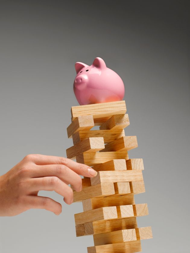 A piggy bank on a Jenga tower, which sums it all up