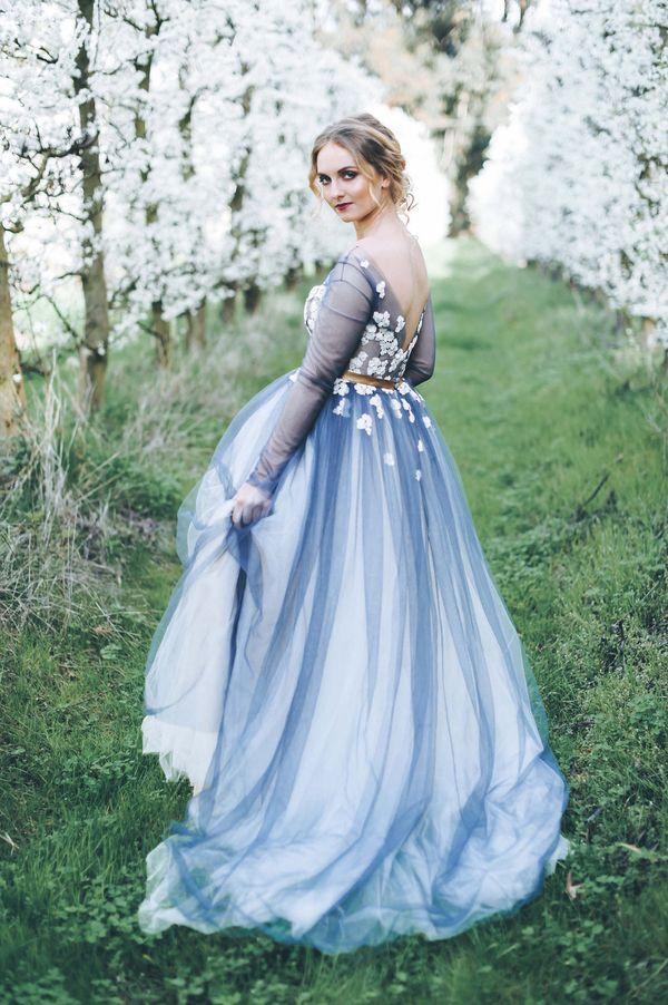 """<i>Gown by <a href=""""http://www.janitatoerien.co.za/"""" target=""""_blank"""">Janita Toerien</a></i>"""