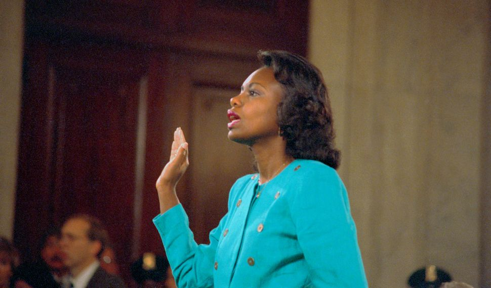 Anita Hill is sworn in before testifying. Hill worked with Clarence Thomas and alleged that he sexually harassed her.