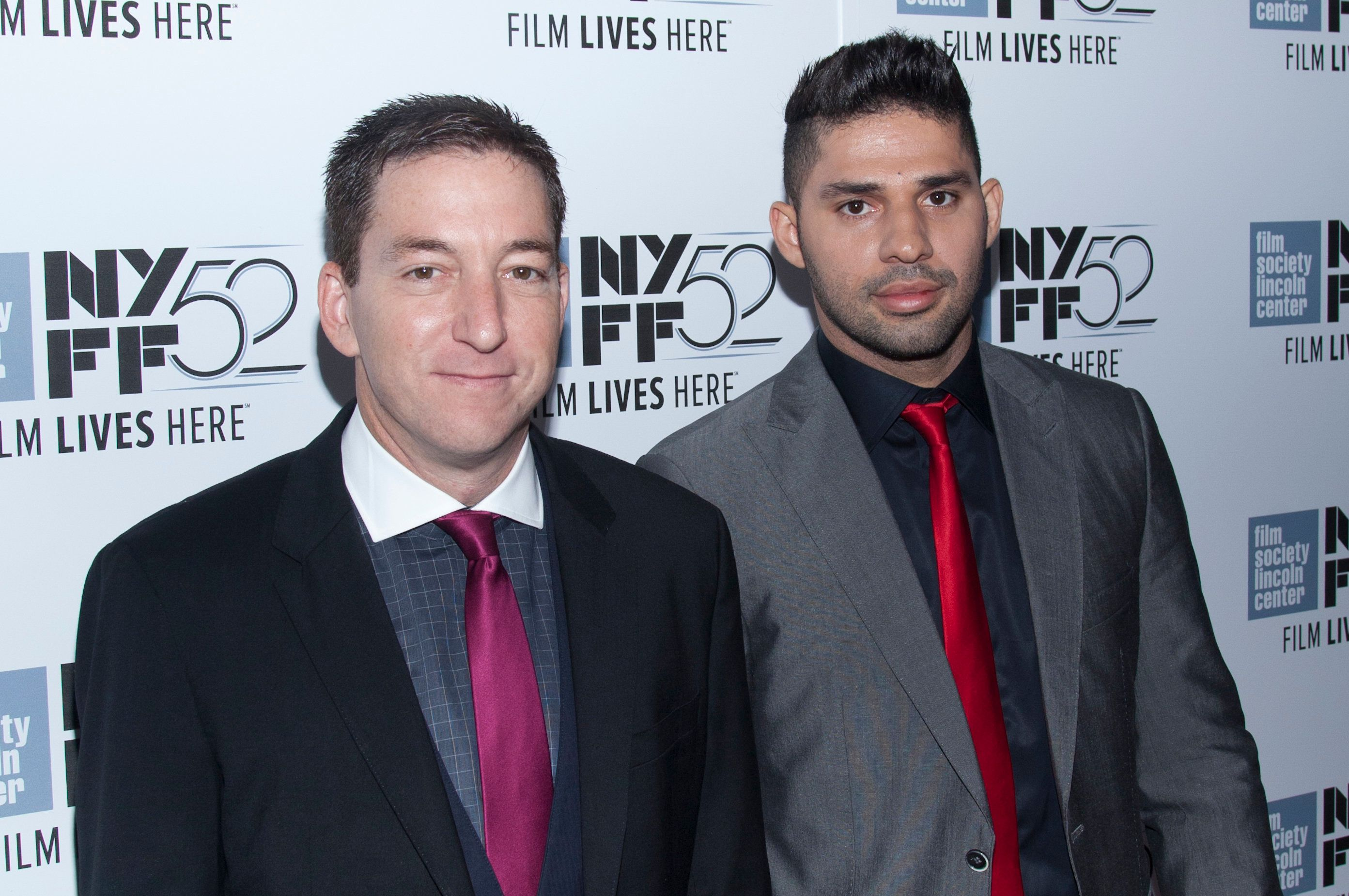 Glenn Greenwald and David Miranda attend the 'Citizenfour' premiere during the 52nd New York Film Festival at Alice Tully Hall in New York City. �� LAN (Photo by Lars Niki/Corbis via Getty Images)