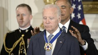 WASHINGTON, DC - JANUARY 12:  (AFP OUT) U.S. President Barack Obama (R) presents the Medal of Freedom to Vice-President Joe Biden during an event  in the State Dinning room of the White House, January 12, 2017 in Washington, DC.  (Photo by Olivier Douliery-Pool/Getty Images)
