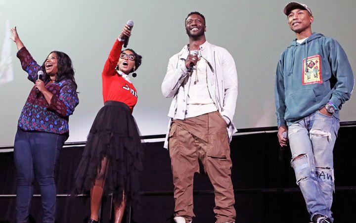 """Stars from the film """"Hidden Figures"""" (from left) Octavia Spencer, Janelle Monáe, Aldis Hodge and Pharrell Williams speak to g"""