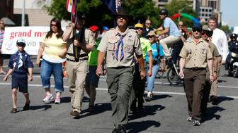Members of the Boys Scouts of America march in a gay pride parade in Salt Lake City, Utah, June 2, 2013. Both Mormons and members of the Boy Scouts marched with members of LGBT community and their supporters as part of the Utah Pride Festival. REUTERS/Jim Urquhart (UNITED STATES - Tags: SOCIETY)