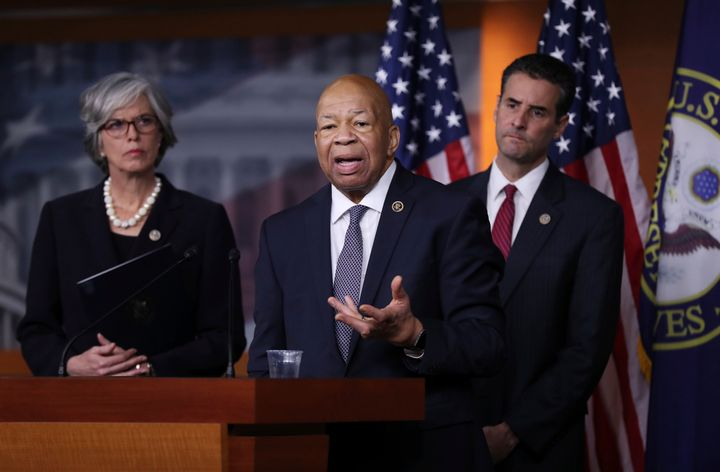 Rep. Elijah Cummings, D-Md., center, accompanied by Rep. John Sarbanes, D-Md., right, and Rep. Katherine Clark, D-Mass., spea