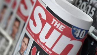 Copies of The Sun newspaper are seen on a newsstand outside a shop in central London January 20, 2015. Britain's The Sun tabloid, the country's best-selling newspaper, has decided to quietly stop publishing photographs of topless models on page three, ending a contested 44-year-old tradition of the Rupert Murdoch-owned paper, The Times reported on Tuesday. REUTERS/Toby Melville (BRITAIN - Tags: MEDIA BUSINESS)