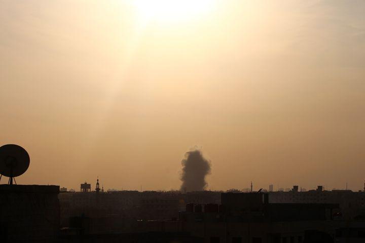 Smoke rises over Douma.