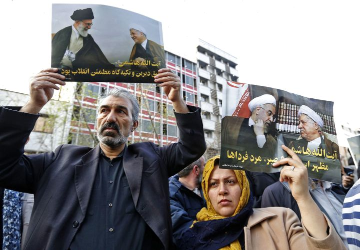 Iranians hold posters of late former Iranian President Akbar Hashemi Rafsanjani during his funeral ceremony in the capital Te