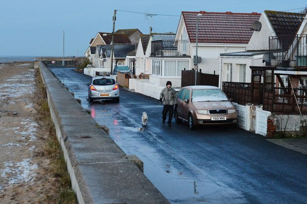 A resident walks his dog along Brooklands Road in Jaywick, Essex, from where police were preparing toevacuating...