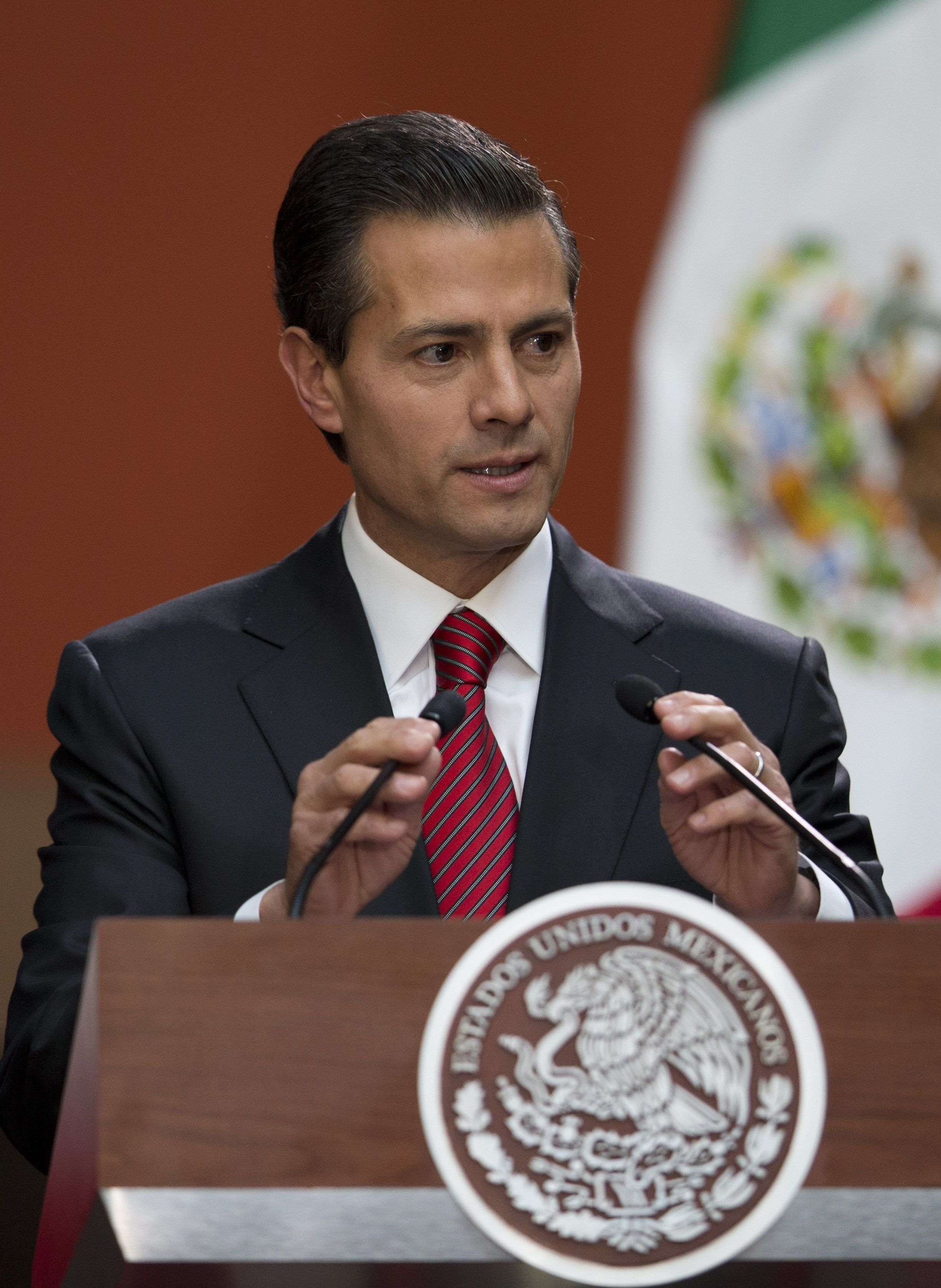 """Mexican President Enrique Pena Nieto speaks at a press conference following the capture of fugitive drug lord Joaquin """"El Chapo"""" Guzman, in Mexico City, Friday, Jan. 8, 2016. Pena announced that Guzman had been recaptured six months after escaping from a maximum security prison. (AP Photo/Rebecca Blackwell)"""