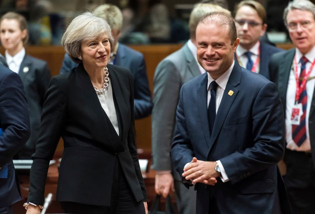 Theresa May, second left, speaks with Malta's Prime Minister Joseph Muscat, third right, during a round...