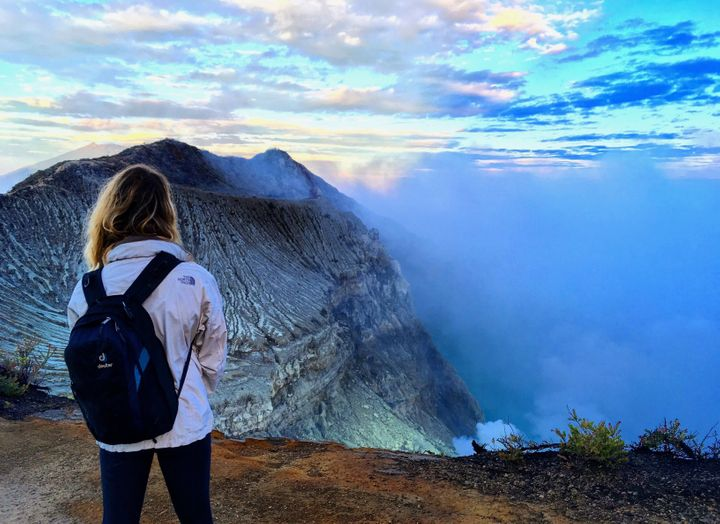 <p>Travel writer Nicole Canning watches the sun rise over the Ijen Crater, Java Island, Indonesia. </p>