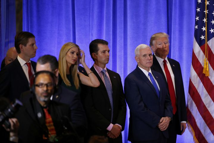 U.S. President-elect Donald Trump stands with Vice President-elect Mike Pence, his sons Donald Trump Jr. and Eric Trump and d