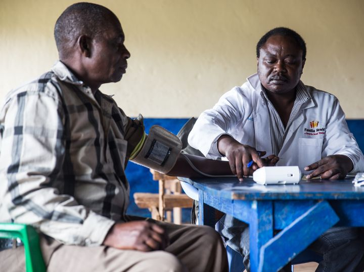 <p>A patient at a rural health camp in Mwae County, Kenya has his blood pressure checked as part of a full physical exam. If needed, non-communicable disease drugs will be made available through Novartis Access, a new program to make NCD drugs available in developing countries.</p>