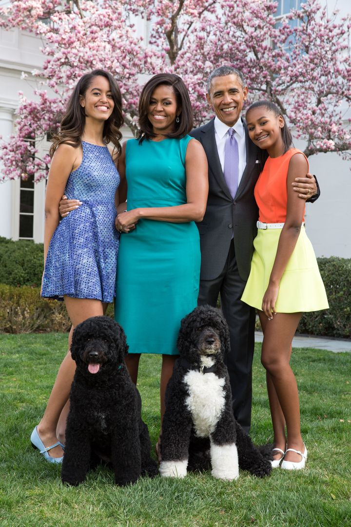 President Barack Obama, First Lady Michelle Obama, and daughters Malia and Sasha pose for a family portrait with their pets Bo and Sunny in the Rose Garden of the White House on Easter Sunday 2015.