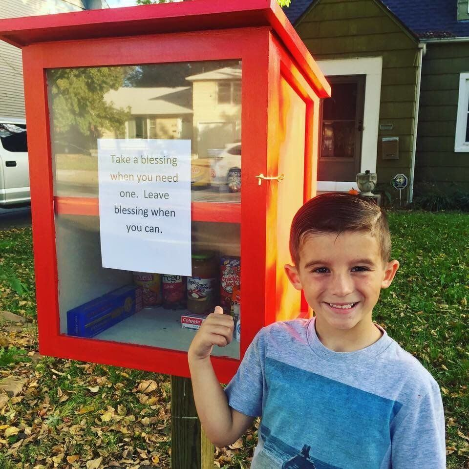 "Maggie Ballard and her 6-year-old son Paxton helped stock their ""blessing box"" with food and hygienic products for people in need."