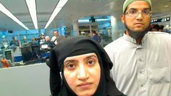 Tashfeen Malik, (L), and Syed Farook are pictured passing through Chicago's O'Hare International Airport in this July 27, 2014 handout photo obtained by Reuters December 8, 2015.  U.S.-born Farook, 28, and his spouse, Malik, a native of Pakistan who lived in Saudi Arabia for more than 20 years, died in a shootout with police hours after a December 2, 2015 attack on a holiday party at the Inland Regional Center social services agency in San Bernardino, California about 60 miles (100 km) east of Los Angeles. REUTERS/US Customs and Border Protection/Handout via Reuters    THIS IMAGE HAS BEEN SUPPLIED BY A THIRD PARTY. IT IS DISTRIBUTED, EXACTLY AS RECEIVED BY REUTERS, AS A SERVICE TO CLIENTS. FOR EDITORIAL USE ONLY. NOT FOR SALE FOR MARKETING OR ADVERTISING CAMPAIGNS