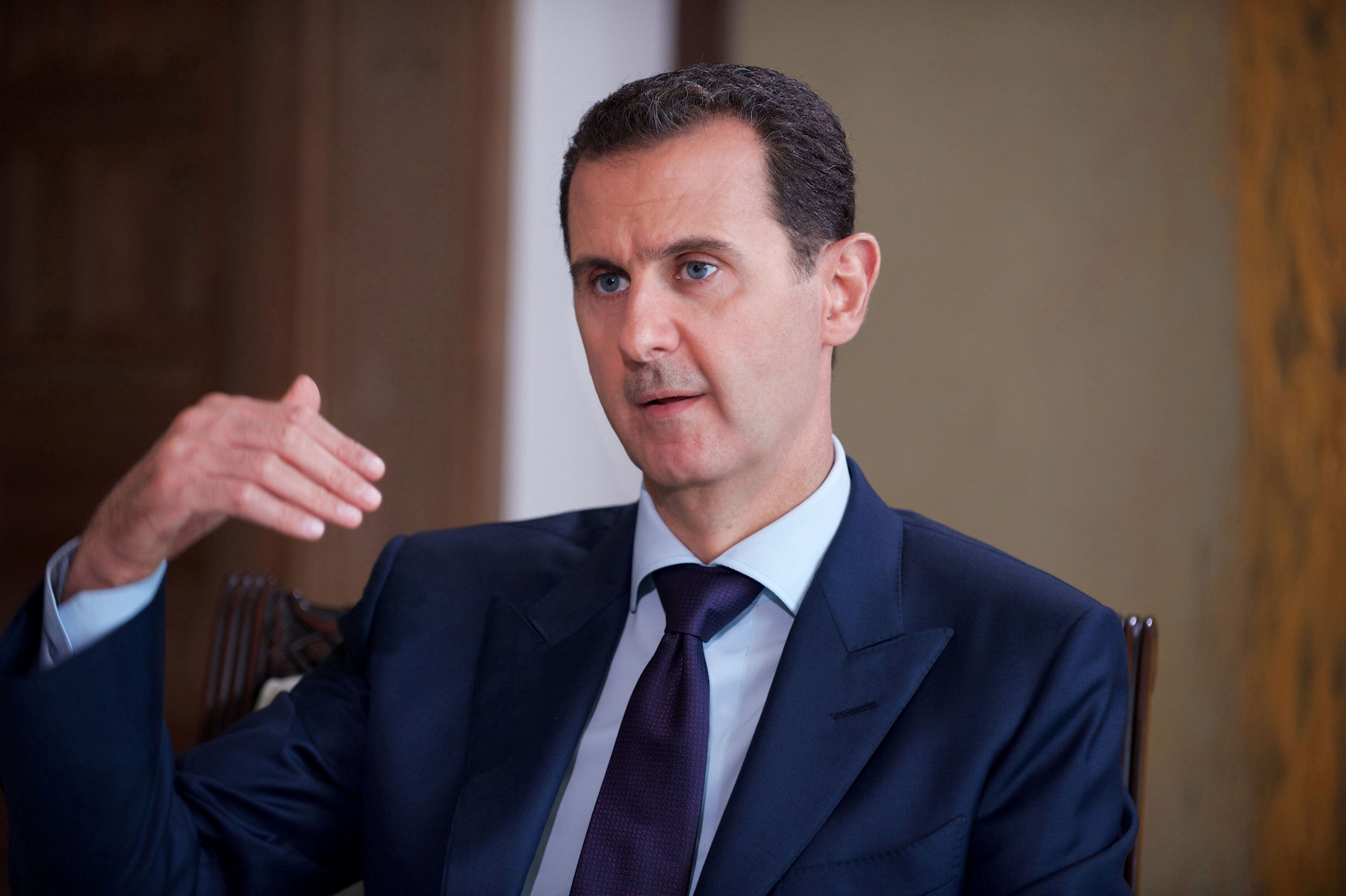 Syria's President Bashar al-Assad speaks during an interview with Australia's SBS News channel in this handout picture provid