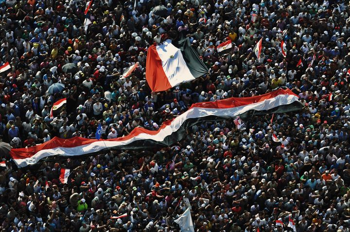 Muslim Brotherhood supporters celebrate in Cairo on June 24, 2012, as their candidate becomesthe first democratically e