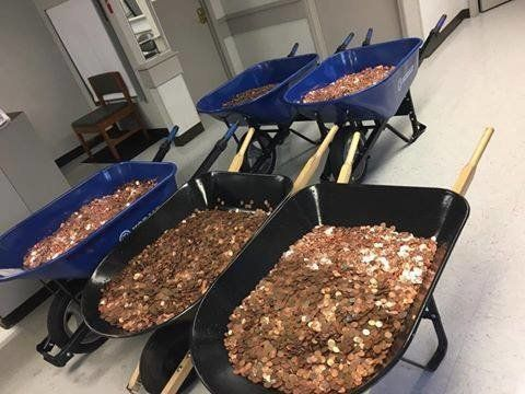 Nick Stafford's five wheelbarrows full of loose coins.