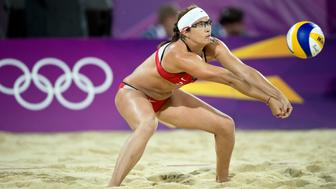 Misty May-Treanor of the United States returned a serve in the gold medal match of women's beach volleyball at Horse Guard Parade during the 2012 Summer Olympic Games in London, England, Wednesday, August 8, 2012. May-Treanor and her partner, Kerri Walsh Jennings, won their third consecutive gold medal. (David Eulitt/Kansas City Star/MCT via Getty Images)