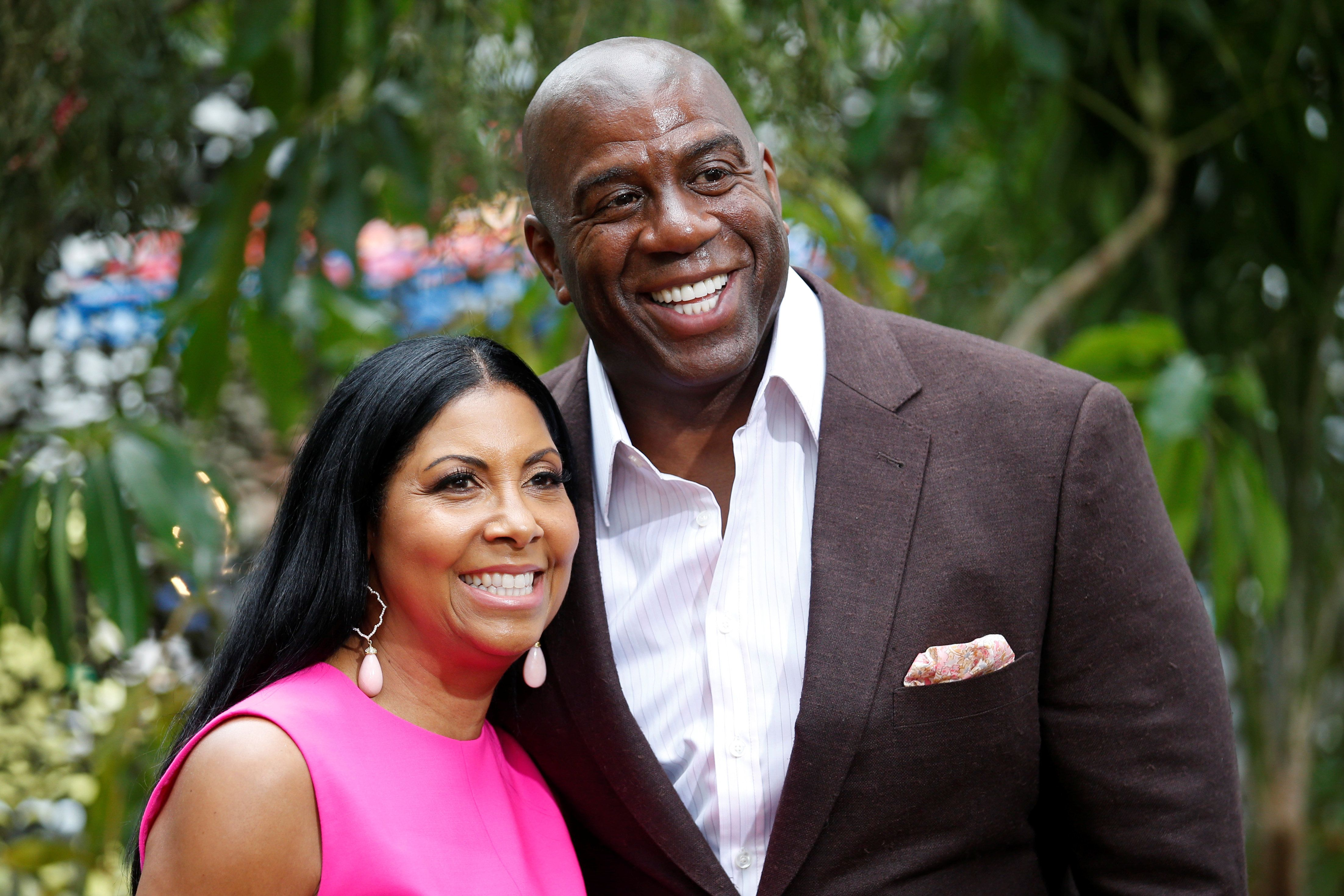 "Former NBA basketball player Earvin Magic Johnson (R) and his wife Cookie Johnson pose at the premiere of the movie ""The Legend of Tarzan"" in Hollywood, California, June 27, 2016. REUTERS/Danny Moloshok"