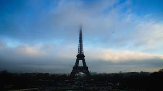 The top of the Eiffel Tower (Tour Eiffel) is surrounded by clouds, in Paris, on January 2, 2017.  / AFP / OLIVIER MORIN        (Photo credit should read OLIVIER MORIN/AFP/Getty Images)