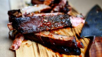 Fresh barbecue ribs are cut into portions