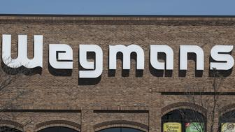 A Wegmans logo is pictured on a building in Syracuse, New York April 15, 2016 REUTERS/Carlo Allegri
