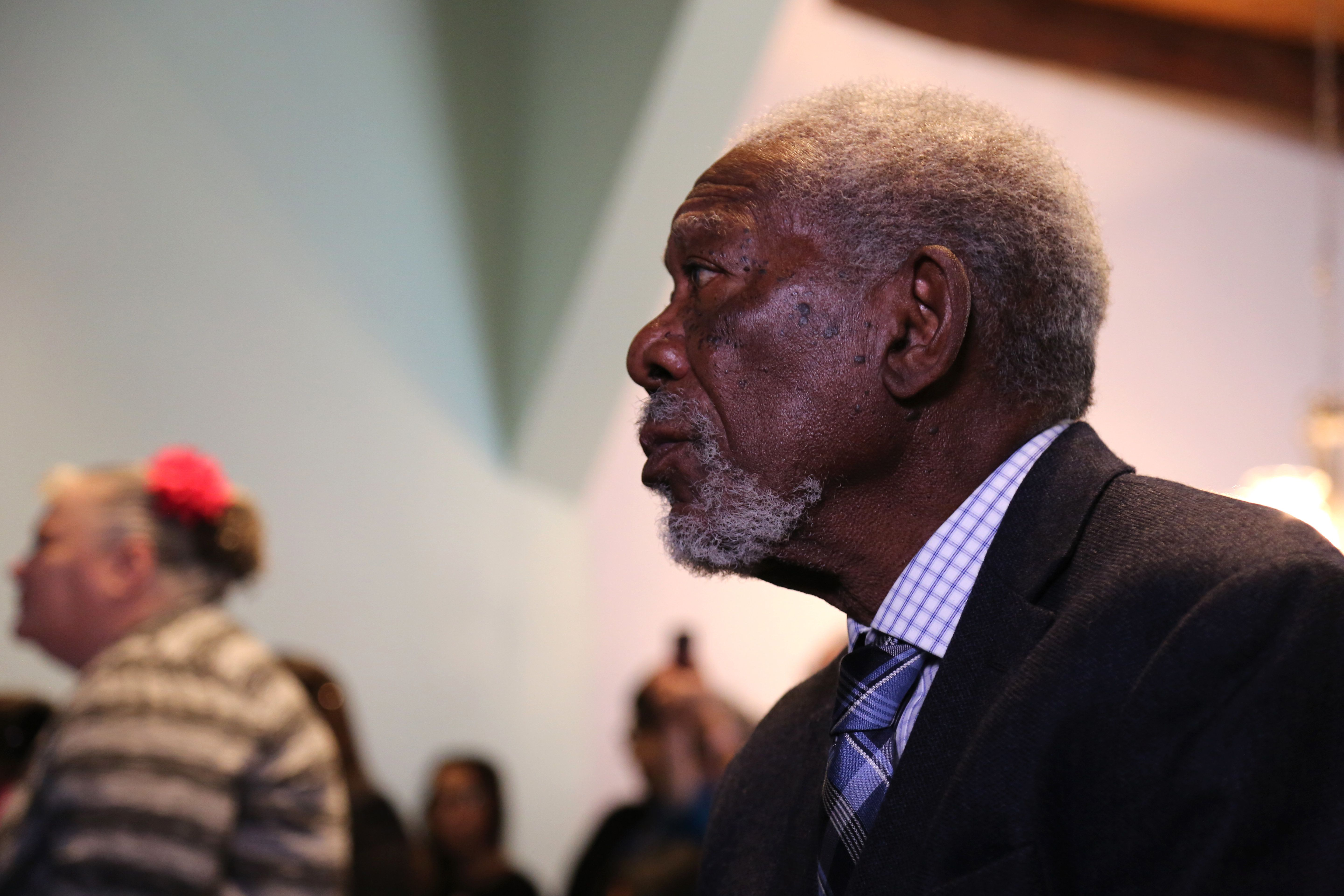 ALBUQUERQUE, NM - Morgan Freeman sits and watches the church service at the New Life United Pentecostal Church. (Photo Credit: National Geographic/Reza Riazi)