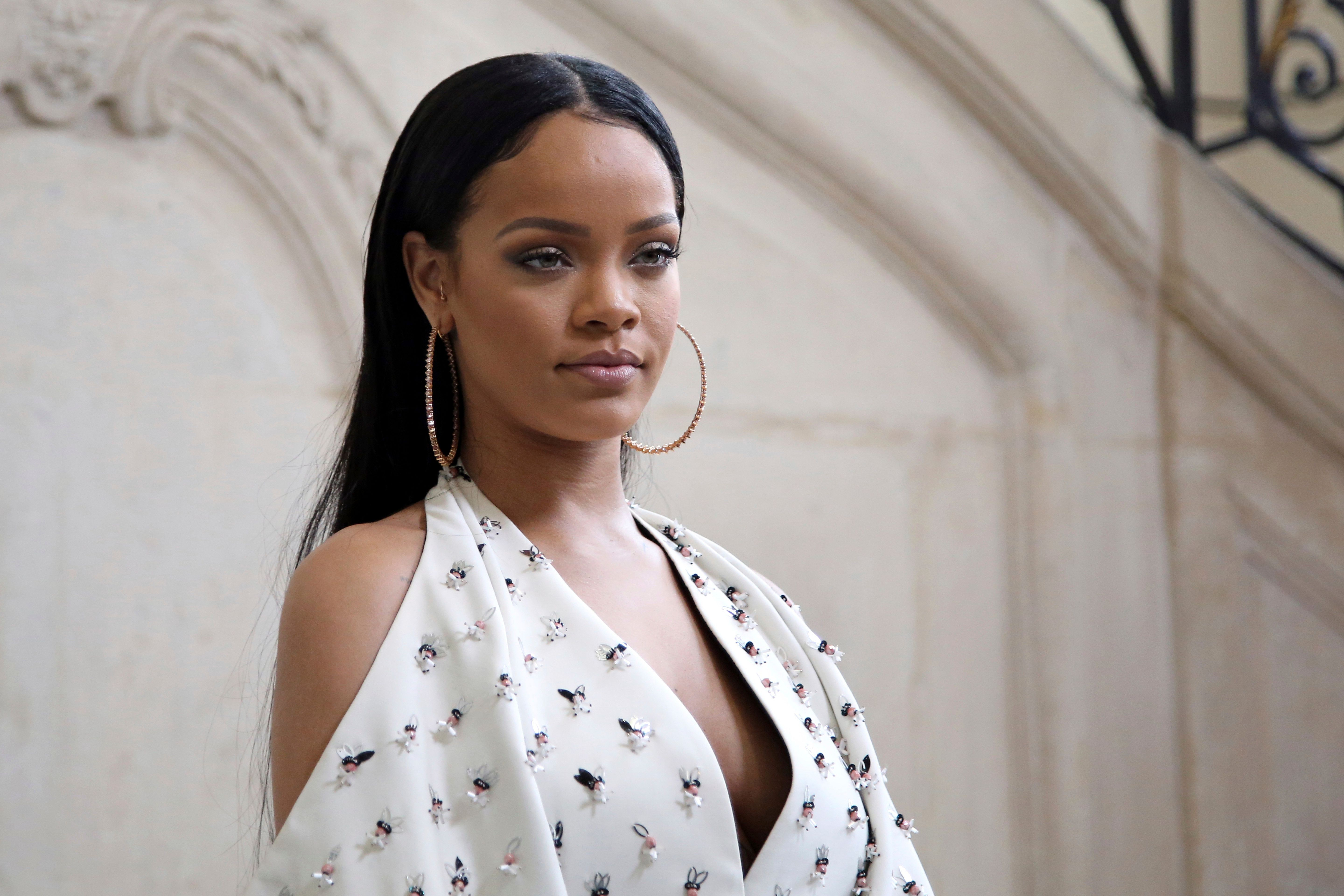 FILE - In this Sept. 30, 2016, file photo, Singer Rihanna poses for photographers as she arrives to Christian Dior's Spring-Summer 2017 ready-to-wear fashion collection presented in Paris. Rihanna posted an emotional plea online for information leading to the whereabouts of missing dancer Shirlene Quigley from New Jersey who also performed with Beyonce and Missy Elliot. (AP Photo/Thibault Camus, File)
