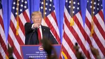NEW YORK, Jan. 11, 2017  -- U.S. President-elect Donald Trump gestures during a news conference in New York, the United States, on Jan. 11, 2017. U.S. President-elect Donald Trump met the press Wednesday for the first news conference since the election. (Xinhua/Gary Hershorn via Getty Images)