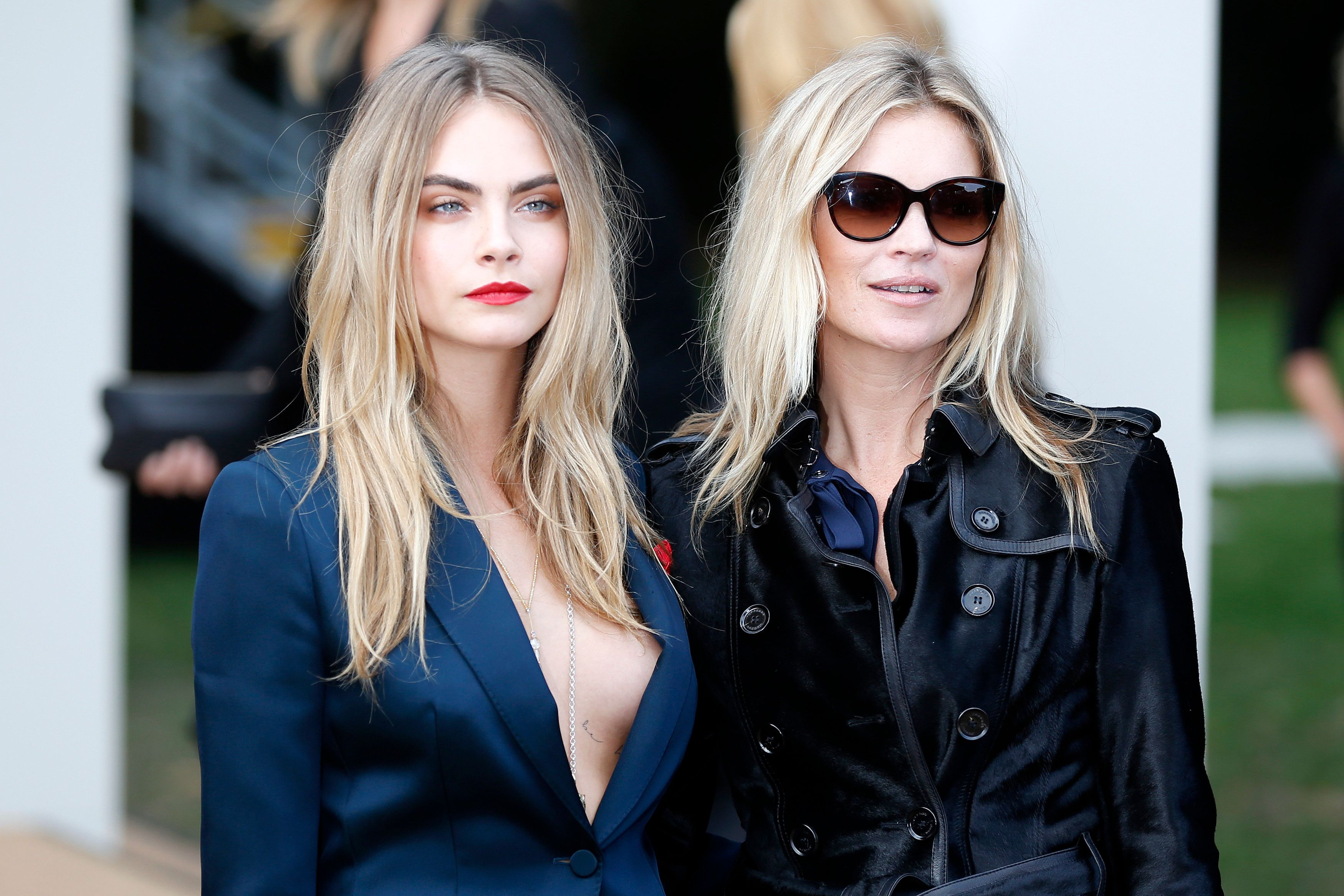 Models Cara Delevingne (L) and Kate Moss arrive to attend the presentation of the Burberry Spring/Summer 2015 collection during London Fashion Week September 15, 2014. REUTERS/Stefan Wermuth (BRITAIN - Tags: FASHION ENTERTAINMENT)