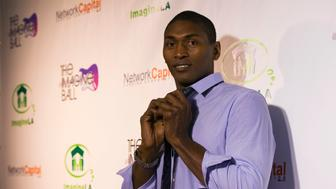 NBA player Metta World Peace poses at the IMAGINE Ball LA Benefit Concert in West Hollywood, California August 6, 2014. REUTERS/Mario Anzuoni  (UNITED STATES - Tags: ENTERTAINMENT SPORT BASKETBALL)