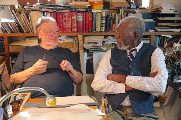 "Master calligrapher Mohamed Zakariya demonstrates his talents to actor Morgan Freeman in an episode of ""The Story of God."""