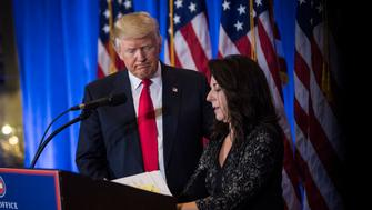 NEW YORK, NY - JANUARY 11: President-elect Donald Trump greets his lawyer lawyer, Sheri A. Dillon, as she speaks during a press conference at Trump Tower in New York, NY on Wednesday, Jan. 11, 2017. (Photo by Jabin Botsford/The Washington Post via Getty Images)