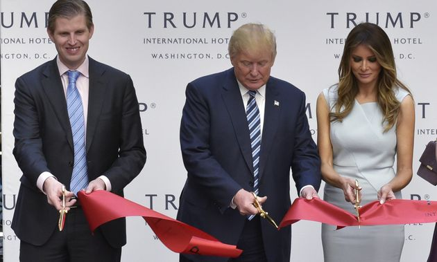 Eric, Donald and Melania Trump cut the ribbon at the grand opening of the Trump International...