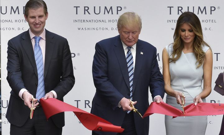 Eric, Donald and Melania Trump cut the ribbon at the grand opening of the Trump International Hotel in Washing