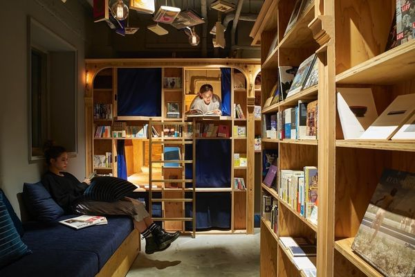 """You'll <a href=""""http://www.boredpanda.com/bookstore-hostel-book-and-bed-tokyo-kyoto/"""" target=""""_blank"""">bunk in a bookcase</a>"""