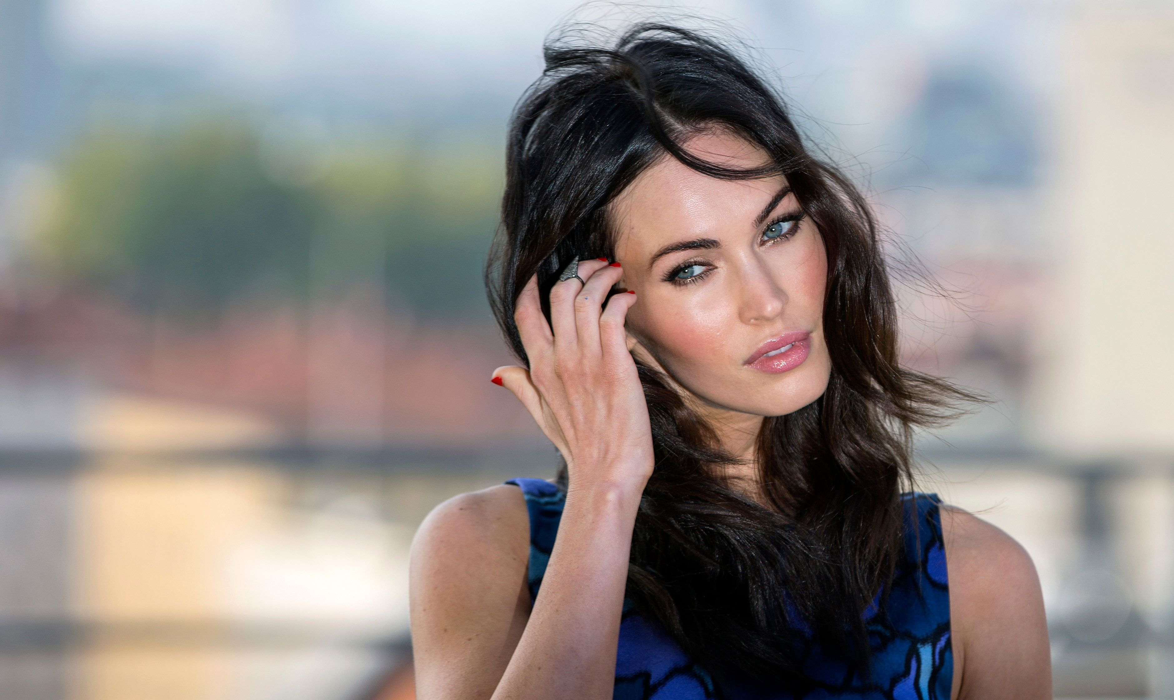"Cast member Megan Fox poses on a roof garden for a photo call for the movie ""Teenage Mutant Ninja Turtles"" in Berlin October 5, 2014. The movie opens in Germany on October 16. REUTERS/Hannibal (GERMANY - Tags: ENTERTAINMENT)"