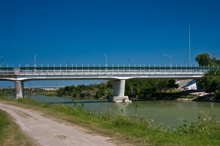The international bridge separating the U.S.-Mexico border between Laredo, Texas and Nuevo Laredo, Mexico. An unknown number