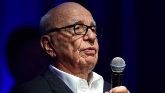 Rupert Murdoch, Executive Chairman of News Corp and 21st Century Fox, offers his critique to finalists at the Global Startup Showcase, as one of four judges at 2015 WSJD Live on October 20, 2015 in Laguna Beach, California. WSJ D Live brings together top CEOs, founders, pioneers, investors and luminaries to explore the most exciting tech opportunities emerging around the world. AFP PHOTO / FREDERIC J. BROWN        (Photo credit should read FREDERIC J. BROWN/AFP/Getty Images)