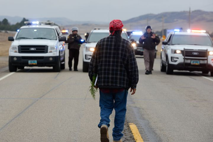 A protester blocks highway 1806 in Mandan during a protest against plans to pass the Dakota Access pipeline near the Standing