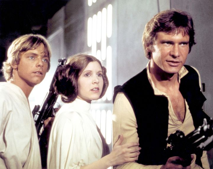 "Mark Hamill, Carrie Fisher and Harrison Ford on the set of ""Star Wars: Episode IV - A New Hope."""
