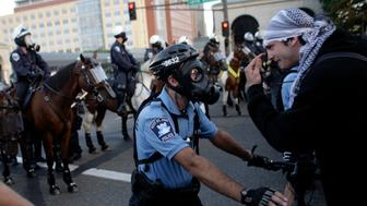Riot police face off with demonstrators as the police block a bridge into downtown St. Paul to keep protesters from getting close to the site at the 2008 Republican National Convention in Minnesota September 4, 2008.  REUTERS/Damir Sagolj           (UNITED STATES)   US PRESIDENTIAL ELECTION CAMPAIGN 2008  (USA)
