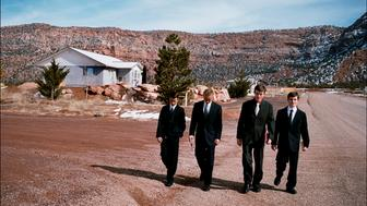 CENTENNIAL PARK, ARIZONA, USA - FEBRUARY, 2008: Four of Ray Timpson's sons on their way to Sunday church in Centennial Park, a small polygamist community located at the border of Utah and Arizona. During service sermons are given by the six leaders of the priesthood council who run the community. Founded in 1986 the Centennial Park group, also known as The Work of Jesus Christ, split from the Fundamentalist Church of Jesus Christ of Latter Day Saints (FLDS) led by infamous jailed polygamist Warren Jeffs and based in Colorado City because of doctrinal differences. (Photo by Stephan Gladieu/Getty Images)