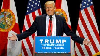 Republican U.S. presidential candidate Donald Trump gestures during a campaign rally in Tampa, Florida, U.S. June 11, 2016. REUTERS/Scott Audette/File Photo