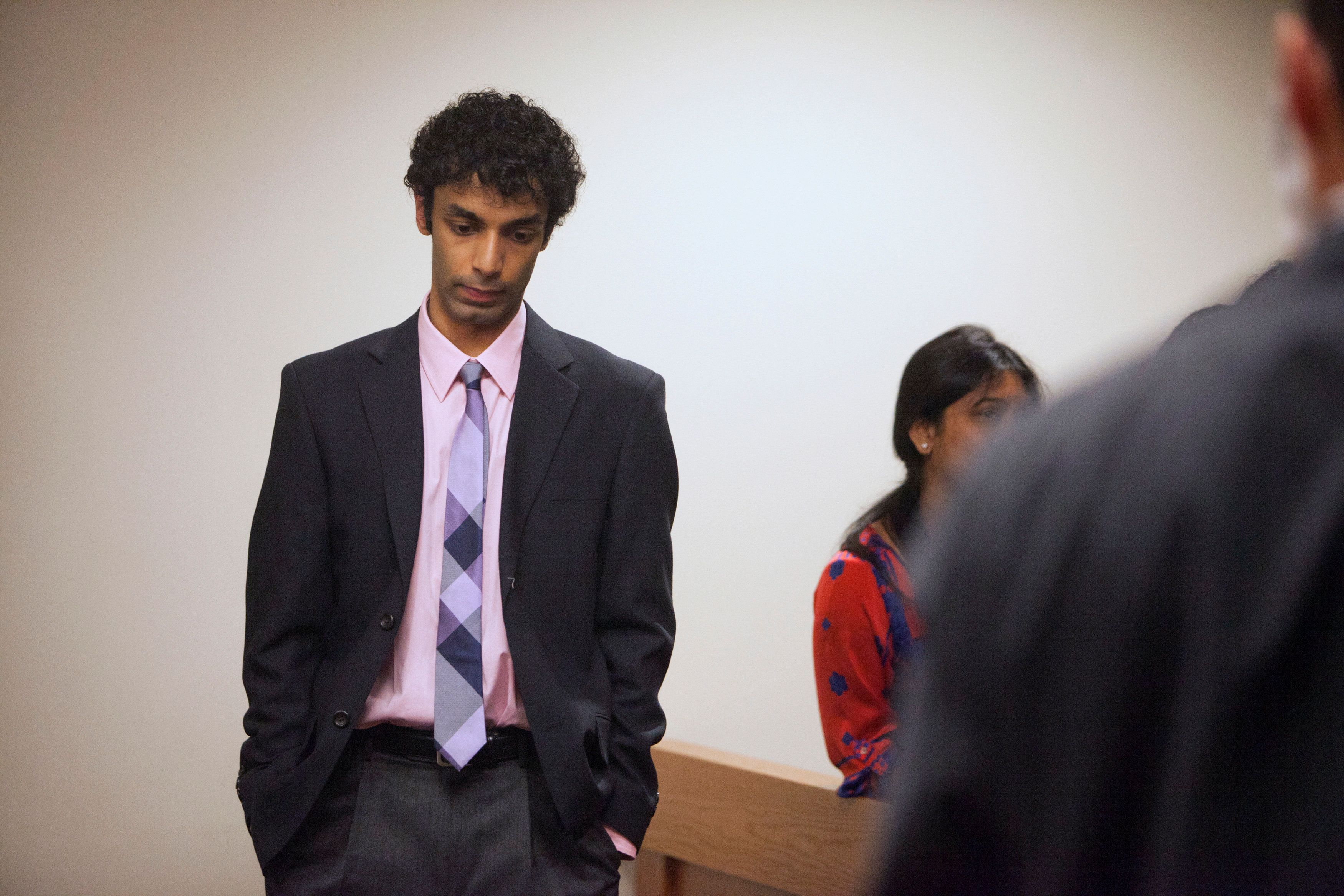 Dharun Ravi stands alone following a sentencing hearing for his conviction in using a webcam to invade the privacy of his roommate, Tyler Clementi, and another man in their college dorm room, in New Brunswick, New Jersey May 21, 2012. The former Rutgers University student was sentenced to 30 days in prison for bias crimes after he spied on his roommate's gay encounter in a case that drew national attention to bullying. REUTERS/Lee Celano (UNITED STATES - Tags: CRIME LAW)