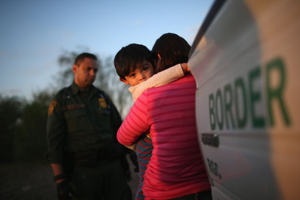 A Salvadoran mother turns herself and her son in to Border Patrol agents near Rio Grande City, Texas, after a 24-day journey
